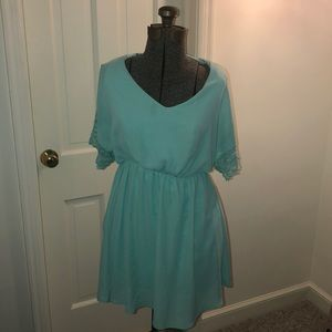 Teal dress with lace bell sleeves